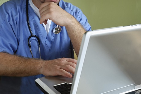 CU Doctor with stethoscope looking at computer #3