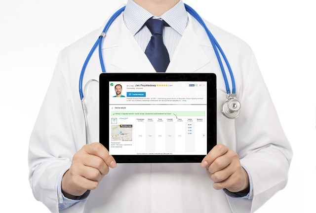 The doctor in a white coat with a stethoscope holding tablet wit