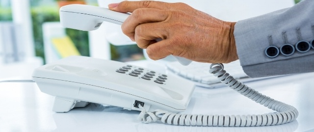 Businessman answering the phone in an office-222563-edited