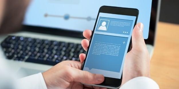 Businessman using smartphone against website interface-509974-edited.jpeg