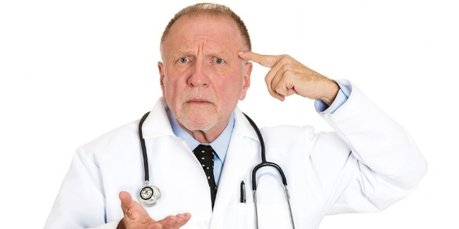 Closeup portrait of puzzled, confused senior doctor, old health care professional gesturing with finger against temple, asking question are you crazy? isolated on white background. Emotion, expression-799018-edited.jpeg