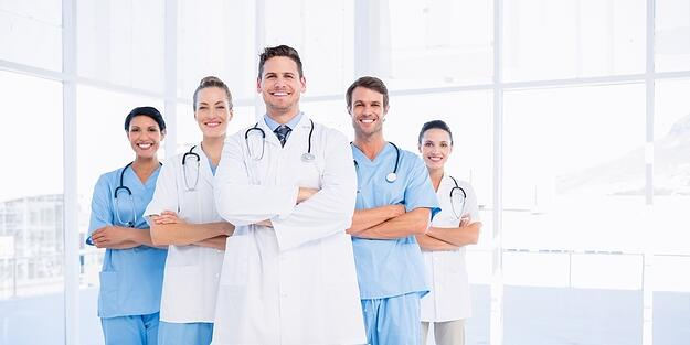 Portrait of confident happy group of doctors standing at the medical office-498102-edited.jpeg