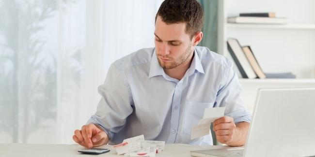 Young businessman calculating-701705-edited.jpeg