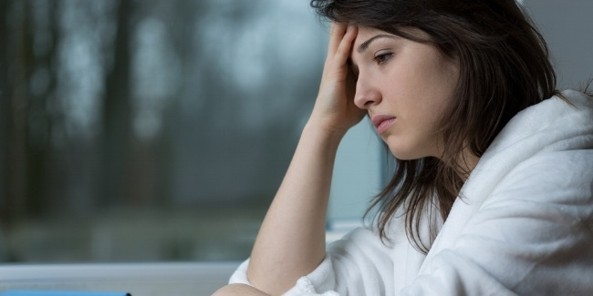 Young depressed woman thinking about her problems-821014-edited.jpeg